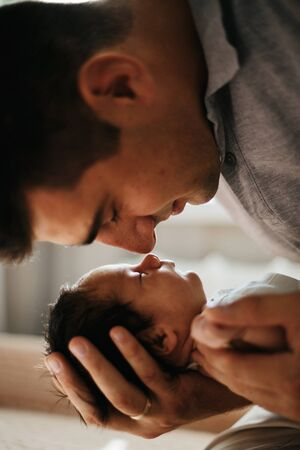 Father and newborn baby boy nose to nose. Lovely family Stock Photo