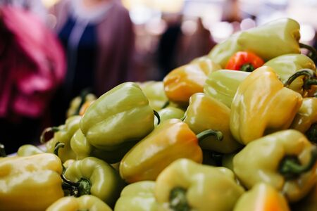 Bell peppers yellow, green and red on white background. Farmer market, organic food 写真素材