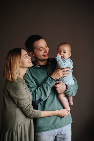Portrait of a young happy family with the kid. Beautiful family hugs Stok Fotoğraf