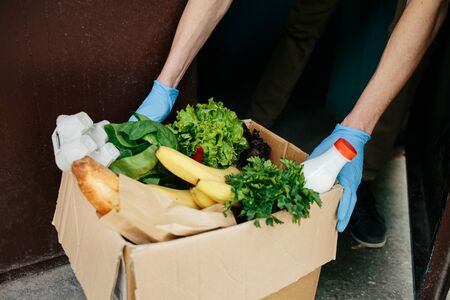 Coronavirus. Quarantine, contactless delivery during a pandemic covid. Stay at home, Online shopping. Food boxes and stamp.
