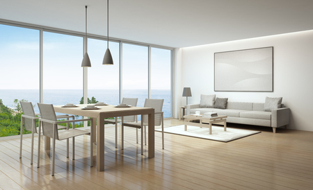 Sea view living room and dining room in luxury house- 3D rendering Stock Photo