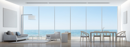 Sea view living room and dining room in modern house with white picture frame - 3D rendering