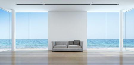 Sea view living room interior in modern beach house - 3D rendering 스톡 콘텐츠