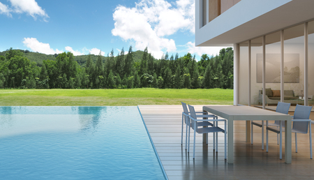 3d swimming pool: house with swimming pool in modern design - 3d rendering Stock Photo