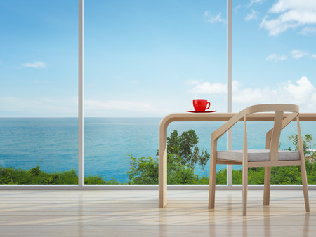home office interior: Sea view interior of home office with red coffee cup - 3d rendering Stock Photo