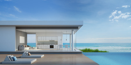 pool tables: Luxury beach house with sea view pool in modern design - 3d rendering Stock Photo