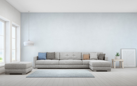 Indoor plant on wooden coffee table and big sofa with empty blue concrete wall background - Home interior 3d rendering