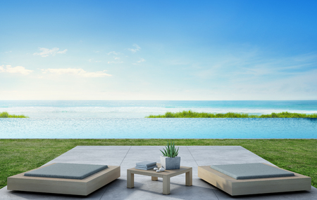 Sea view swimming pool beside terrace and modern furniture in luxury beach house with blue sky background, Lounge for outdoor living at vacation home or hotel - 3d illustration of tourist resort