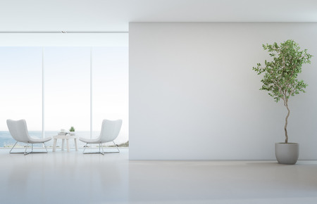 Indoor plant on white floor with empty concrete wall background, Lounge and coffee table near glass window in sea view living room of modern luxury beach house or hotel - Home interior 3d illustration