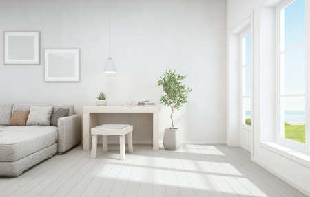 Sea view living room and small working area of modern luxury beach house. Wooden desk with sofa near white window in vacation home or holiday villa. Interior 3d illustration