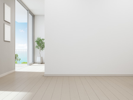 Sea view living room of luxury beach house with indoor plant near glass door and wooden floor terrace. Empty white wall background in vacation home or holiday villa. Hotel interior 3d illustration Stock Photo