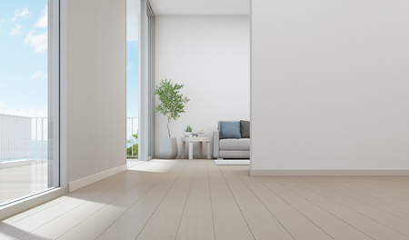 Sea view living room of luxury beach house with indoor plant near glass door and wooden floor terrace. Empty white wall background in vacation home or holiday villa. Hotel interior 3d illustration Foto de archivo