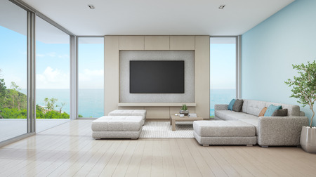 Sea view living room of luxury beach house with glass door and wooden terrace. Large white sofa against blue wall near TV in vacation home or holiday villa for big family. Hotel interior 3d rendering. 版權商用圖片