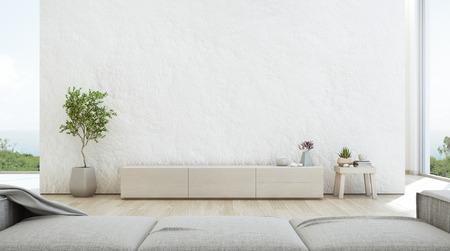 Wohnzimmer mit Meerblick und luxuriösem Sommerstrandhaus mit TV-Ständer und Holzschrank. Leerer rauer weißer Betonwandhintergrund im Ferienhaus oder in der Ferienvilla. 3D-Illustration des Hotelinnenraums.