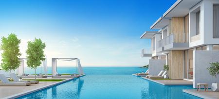 Casa sulla spiaggia di lusso con piscina vista mare e terrazza dal design moderno, sedie a sdraio sul ponte del pavimento in legno a casa per le vacanze o in hotel - illustrazione 3D dell'esterno della villa per le vacanze contemporanea Archivio Fotografico