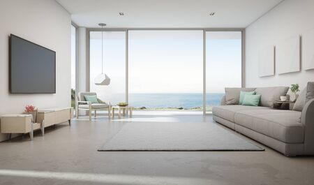 Sea view living room of luxury summer beach house with large glass door and wooden terrace. TV on white wall against big gray sofa in vacation home or holiday villa. Hotel interior 3d illustration. 版權商用圖片