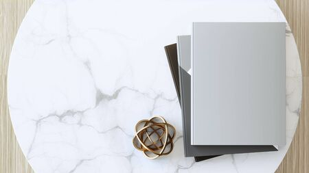 Blank cover book or magazine on empty white marble table. 3d rendering of golden sphere decoration in modern office.