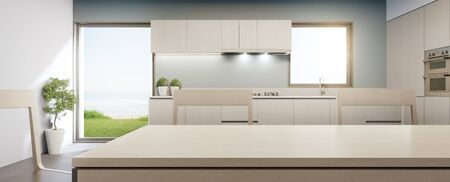 Big glass window near counter and cabinet of modern sea view kitchen in luxury summer beach house. Dining room 3d rendering for product display mock up on empty clean wooden top table.