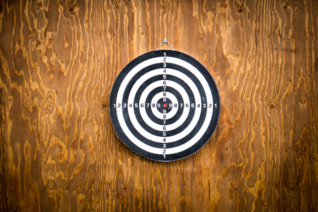empty space: Empty dartboard on wooden background, free space