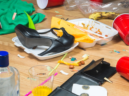 no heels: High heels, food leftovers and trash everywhere after awesome party. Next morning regret and remorse. Messy home needs cleaning. Funny hangover and wild partying concept.