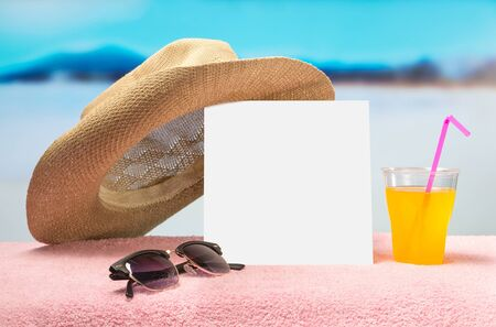 Summer sales or offer banner template. White square paper on towel with sunglasses, yellow cocktail and fun hat. Free blank copy space for text and content. Beautiful perfect ocean paradise background