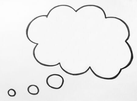 Thought cloud and thinking speech bubble balloon hand drawn on paper.