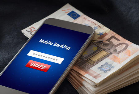 Mobile banking hack and cyber security concept. Hacker and criminal login to persons online bank application and steal money from account. Smartphone and stack of money and 50 euro bills.