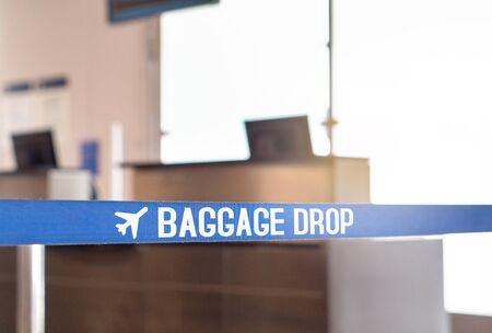 Baggage drop at airport. Luggage desk in terminal.