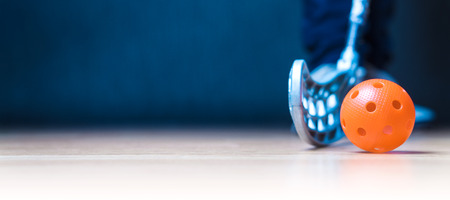 Floorball banner with ball, stick and player. Floor hockey concept. Negative copy space. Stockfoto