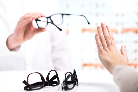 Problem at optician. Unhappy customer refuse to try or don't like new glasses. Bad service in spectacles store. Disappointed and angry patient. Too expensive eyeglasses.