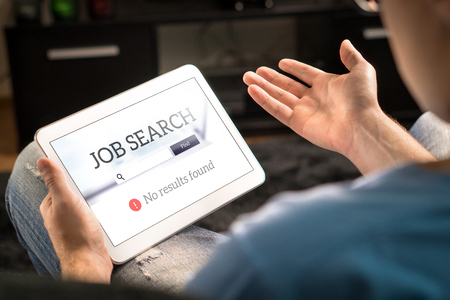 Unemployment and job search problem. Unhappy and frustrated man can't find work with tablet. No results found in online search engine. Sad, disappointed and depressed jobseeker. Jobless applicant. Stock Photo - 95800348
