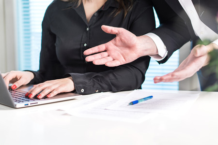Disappointed or angry boss yelling at employee. Unhappy manager talking to bad assistant or secretary. Businessman spreading hands in office with coworker woman. Business discussion or problem.