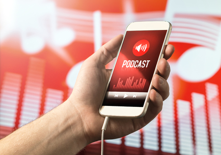 Hand holding smartphone with podcast app on screen. Mobile phone with application on abstract background.