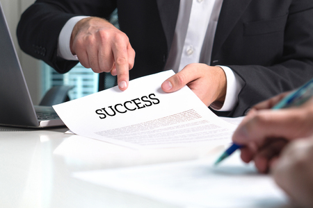 Strategy to success. Professional business man and management consultant giving advice to entrepreneur with new company. Advisor, mentor or teacher giving guidance and teaching.