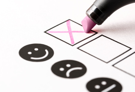 Experience survey, employee feedback questionnaire or business poll concept. Happy person giving positive rating and review with smiling face. Customer loyalty and trust. Check box and marker pen.