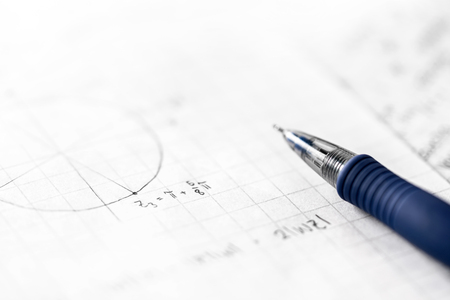 Studying mathematics and science concept. Notes in math class. Geometry, numbers, equation or formula on paper with pen. Homework, exam, assignment, lesson or project in school, college or university