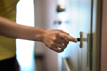 Hand on door bell. Finger ringing doorbell. Neighbor or female guest surprise visiting. Stok Fotoğraf