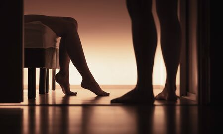 Couple about to have sex. Sexual woman and man in home bedroom. Naked married or dating people. First time and losing virginity. Two young virgins. Silhouette bodies in dark shadows.