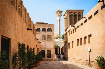 Old Dubai view with mosque, buildings and traditional Arabian street. Historical Al Fahidi neighbourhood, Al Bastakiya. Heritage district in United Arab Emirates (UAE). Reklamní fotografie