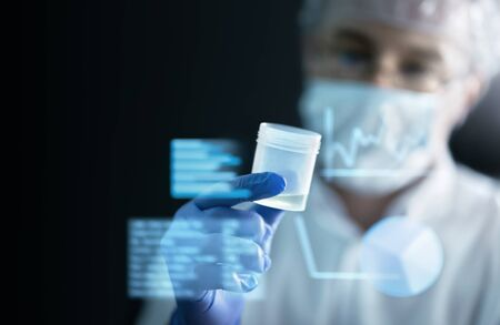 Scientist in laboratory doing medical research with future health care technology. AR screen and futuristic interface. Digital information about medicine. Doctor working in lab. Dark background. Reklamní fotografie