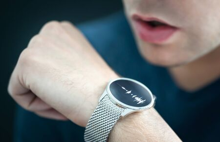 Voice recording or speech recognition technology in smart watch. Man talking to smartwatch mic and recorder. Personal assistant app to give command or send message. Modern wearable AI sound tech.