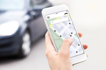 Car or ride share mobile app in smartphone. Carsharing, ridesharing or carpool service. Sharing economy concept. Person ordering taxi online with phone. Map location in screen. Automobile rent system.