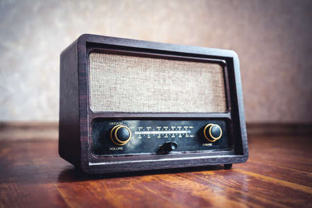 Retro radio. Old vintage music player in 60s style. Dusty receiver, speaker and boombox. Technology nostalgia. Knobs and frequency tuner. Stereo sound for songs, news broadcast or propaganda.