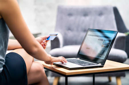 Business woman using credit card payment to purchase. Online bank identification and website in laptop. E commerce transaction data and information for security from fraud. Electronic money transfer. 版權商用圖片