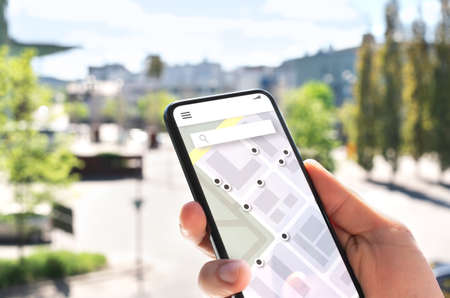 Map app in mobile phone to search location or navigate to destination in city. Place marker and pointer icon. Online GPS guide in smartphone. Geo satellite technology for tracking route and direction.