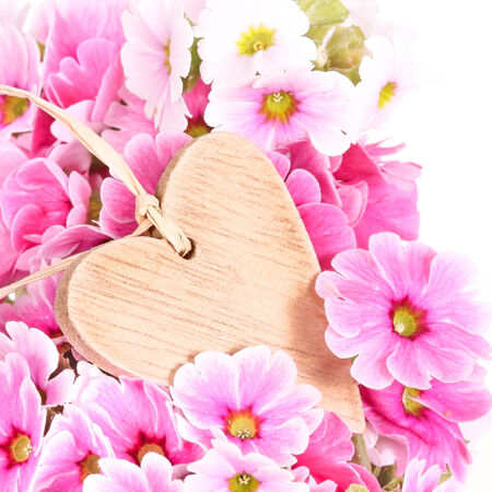 Wooden heart-tag with flowers photo