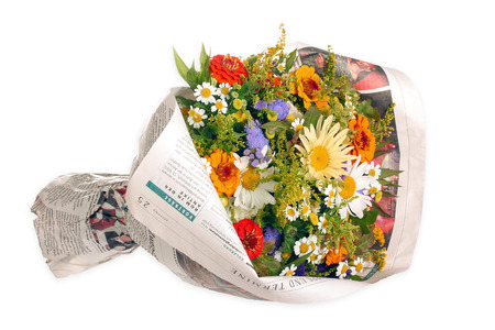 Bouquet of flowers in a newspaper