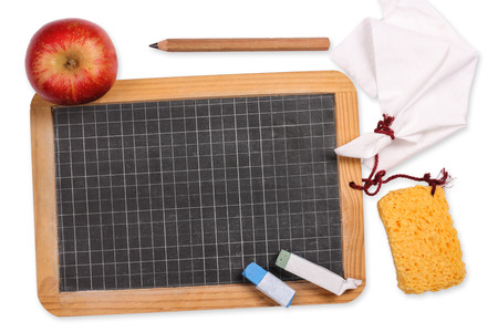 Blackboard with apple, sponge, chalk, cloth and pencil photo
