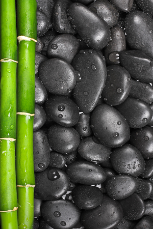 Hot stones with bamboo, background Stockfoto
