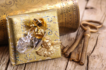 old key: Golden gift with keys Stock Photo